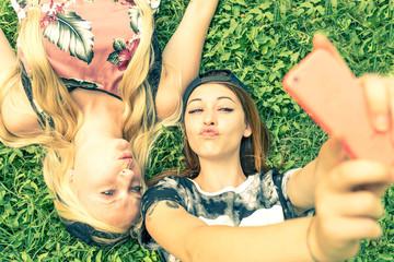 Two girls smiling at camera