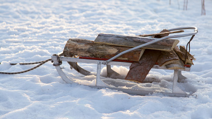 sleigh with a log in the snow