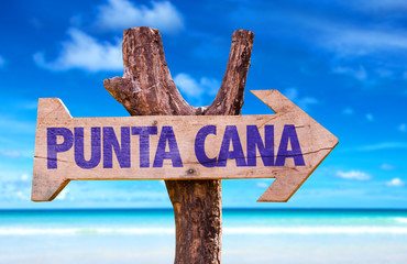 Punta Cana wooden sign with beach background