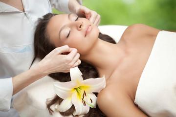 Spa salon: Young Beautiful Woman Having Facial Massage