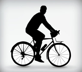 Silhouette of a man riding a bike isolated on a white background