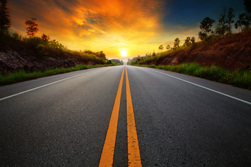 beautiful sun rising sky with asphalt highways road in rural sce Wall mural
