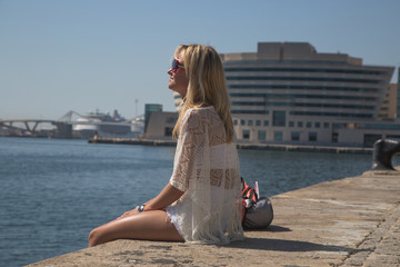 Young woman enjoys the sun in Barcelona.