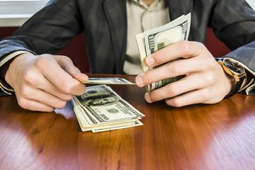 businessman counts money, profit dollars