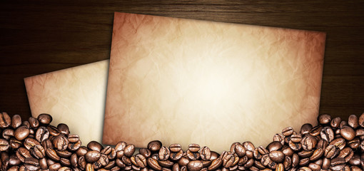 coffee beans and paper old on a wooden table. Dark background