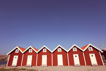 Red houses in row, with blue sky