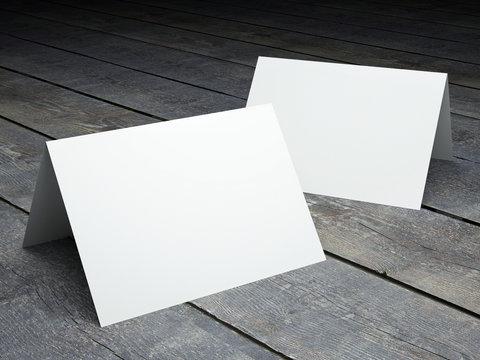 Blank template of folded postcard on a wood floor