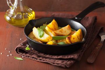 baked potato wedges in black frying pan