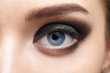 Closeup of beautiful woman eye with makeup, eyeliner