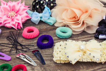 Different hair clips on wooden background