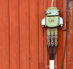Electric junction boxes, retro style on red wall-2