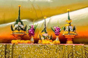 The yellow flower garlands on tray with pedestal in thai temple,