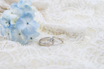 wedding ring with blue hydrangea on  ivory lace