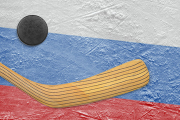 Hockey puck, hockey stick and a Russian flag
