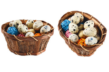 Isolated quail eggs in a basket with decorative wooden balls