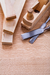 carpentry chisels woodworkers plane and planks on wooden board