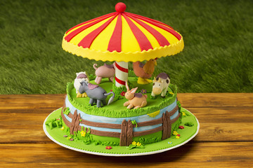 Fondant music themed cake on picnic table