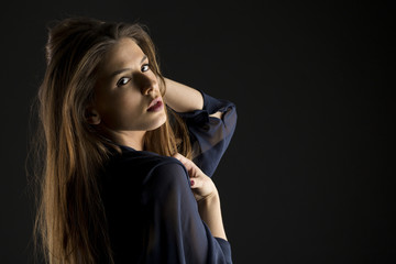 beautiful woman with brown hair in studio shooting