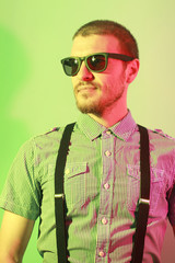Portrait of handsome casual stylish young man in sunglasses