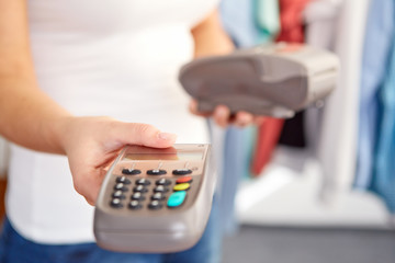 Female hand gives payment terminal