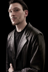 Male portrait wearing leather coat and looking