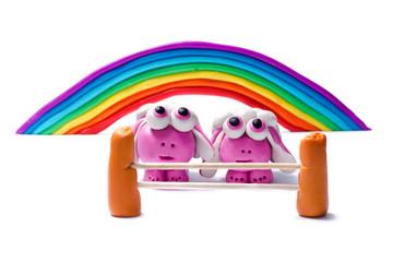 Rainbow and two plasticine sheep.