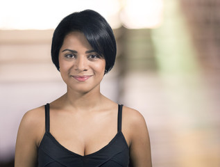 Young woman with short hair smiling