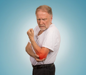 senior man with red elbow inflammation suffering from pain