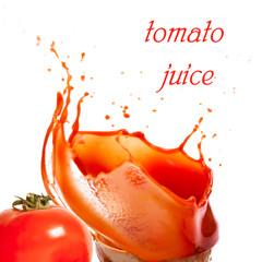 Splashes of tomato juice and tomato on white background