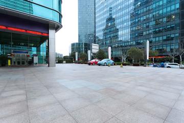 Empty road near modern building exterior