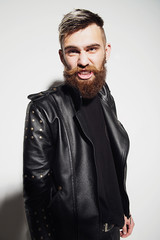 Emotional portrait of a bearded man in a leather jacket