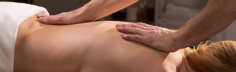 Male hands doing back massage