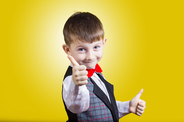 Smiling little boy with thumb up gesture