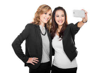 two young businesswoman take a self photo together, isolated