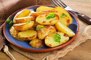 Fried potato with a fresh herb.