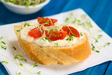 Baguette with cream cheese, cherry tomato, alfalfa sprouts