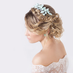 elegant beautiful girl in image of bride with flowers in hair