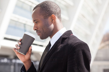 black businessman drinking coffee during a lunch