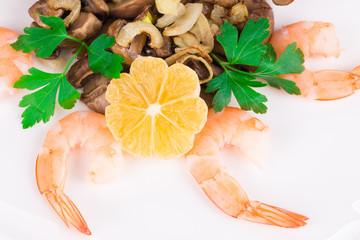 Shrimp salad with mushrooms close up.