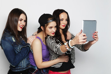 girls friends taking selfie with digital tablet