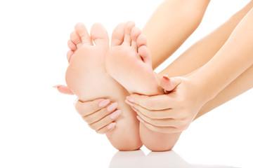 Woman touching her feet.