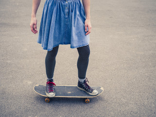 Young woman skateboarding in the park