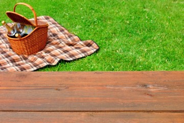 Aluminium Prints Picnic Picnic Tabletop Close-up. Picnic Basket and Blanket On The Lawn