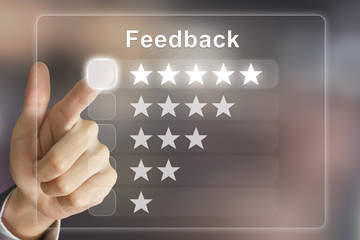 business hand pushing feedback on virtual screen