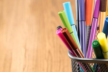 Colorful pen in metal pen pot