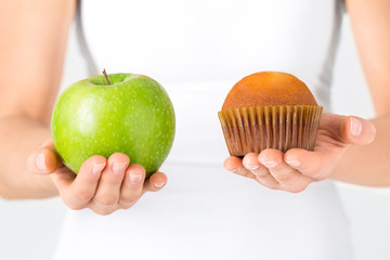 Woman making decision between healthy food or sweets. Dieting
