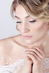 elegant beautiful girl in image of bride with flowers in hair