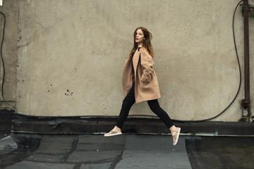 beautiful hipster girl running outdoors