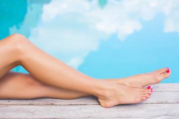 Beautiful women legs by the pool