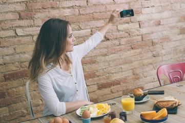 taking a self photo while having breakfast